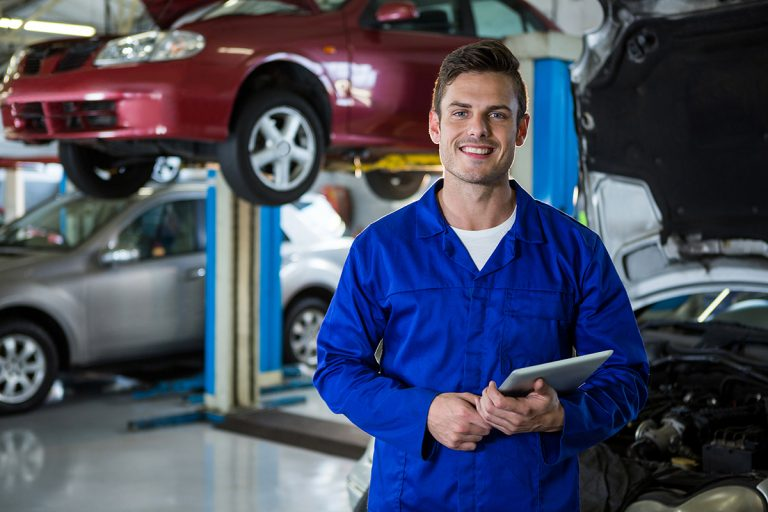 Mechanic holding digital tablet