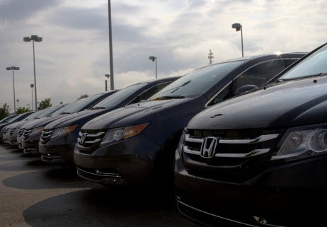 Line up of Honda cars in parking lot